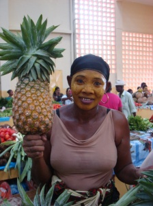 Woman holding a giant pineapple from Madagascar